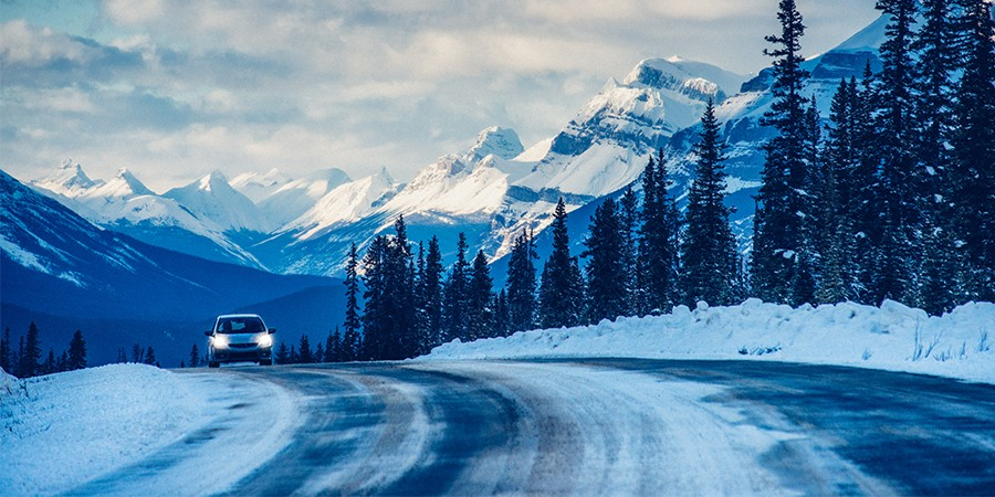 Car-On-Snowy-Road-With-Headlights-On-Thumbnail